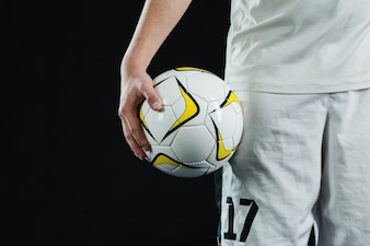Close-up of soccer player with ball