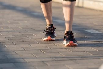 Close-up of sportswoman with sneakers