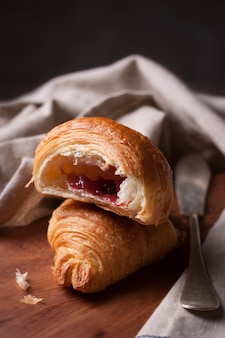 Close-up of tasty croissant with jam