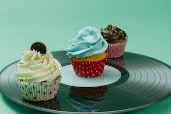 Close-up of tasty cupcakes with different toppings