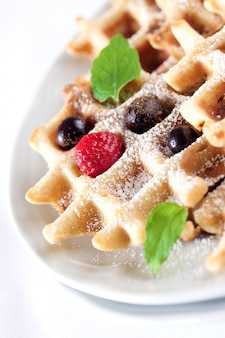 Close-up of tasty waffle with fruits
