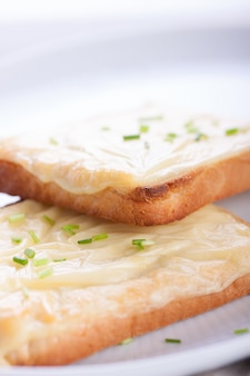 Close-up of toasts with melted cheese