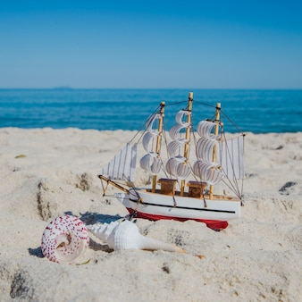 Close-up of toy ship on sand