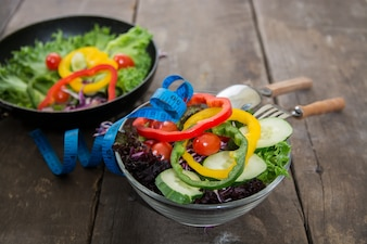 Close-up of two bowls with salad on the wooden table