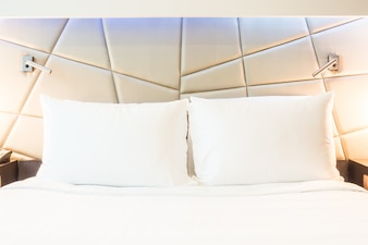 Close-up of two pillows with white covers