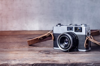 Close-up of vintage camera on wooden table