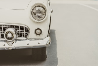 Close-up of vintage car in black and white