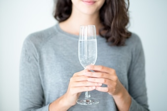 Close-up of woman holding champagne flute