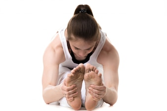 Close-up of woman holding her feet