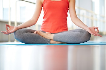 Close-up of woman meditating in gym