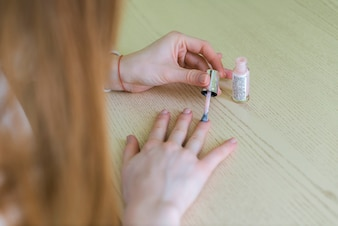 Close-up of woman painting her nails