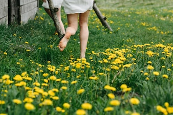 Close-up of woman running on the grass