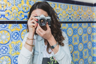 Close-up of woman taking a photograph