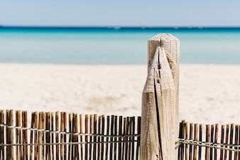 Close-up of wooden fence on the beach