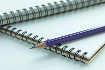 Close up pencil and spiral notebook, Selective focus point