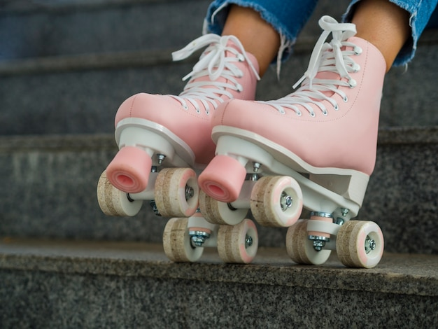 Close-up of side view of roller skates and stairs