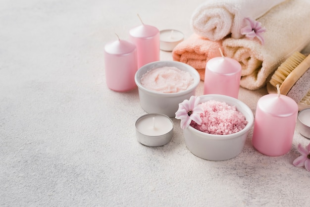 Close-up skincare spa candles with towel