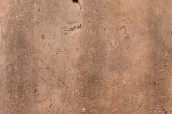 Close up stained light brown wall