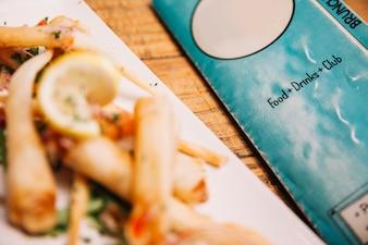 Close up view of asian dish next to menu