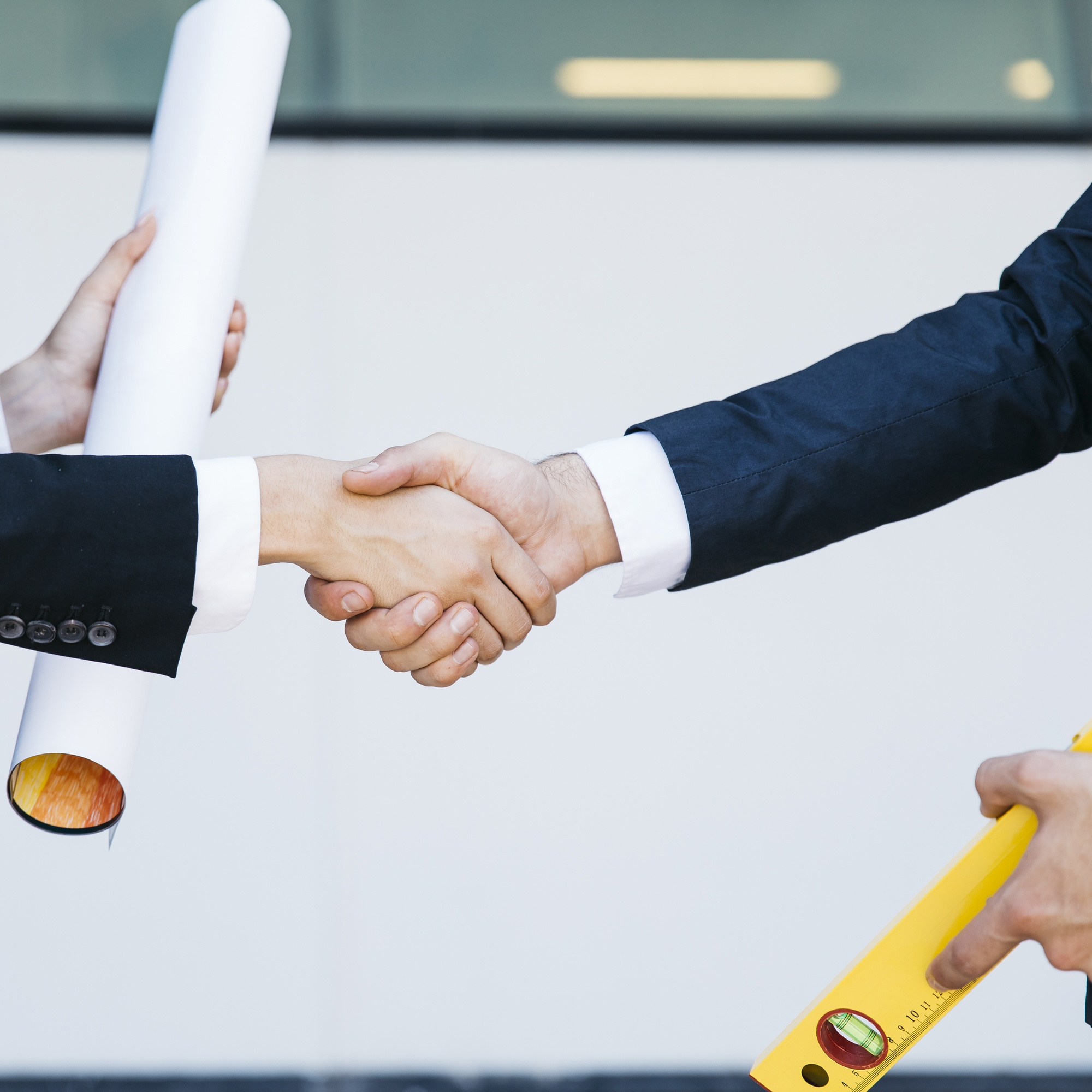 Close up view of businessman and businesswoman shaking hands