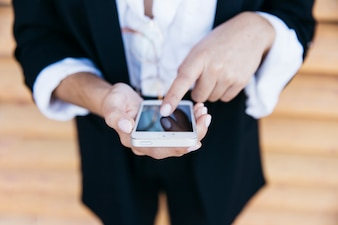 Close up view of businesswoman with smartphone