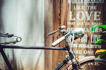 Close up vintage bicycle with wooden art wall
