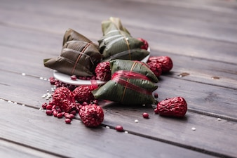 Closed zongzi with red fruits