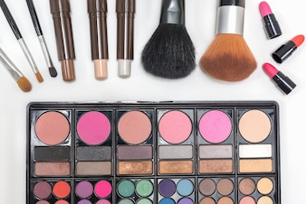 Closeup makeup cosmetics palette lipstick and brushes