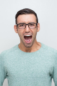Closeup of Angry Young Man Shouting Loud