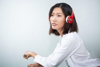 Closeup of Charming Young Woman Listening to Music