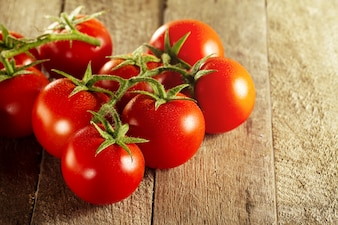 Closeup of fresh tasty red tomatoes. Sunny daylight. Healthy food or italian food concept.