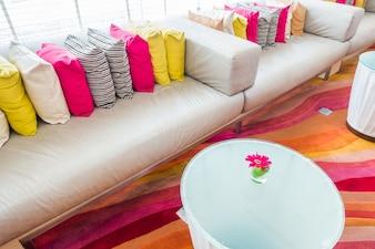 Closeup of modern furniture with pillows .