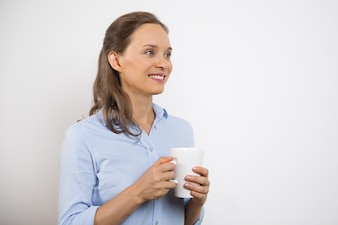 Closeup of Positive Young Pretty Woman with Mug