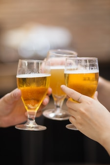 Closeup of Three Glasses of Beer Being Clinked