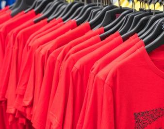 Clothes hang on shelf
