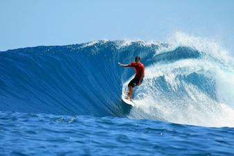 Cloud board man surfing water