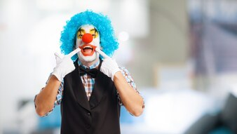 Clown marking his smile with his hands
