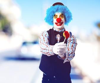 Clown offering a lollipop