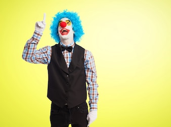 Clown pointing to the sky