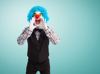 Clown screaming with hands in mouth