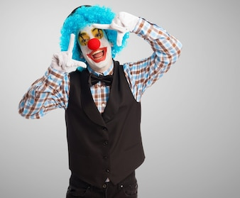 Clown with a big smile playing with his hands