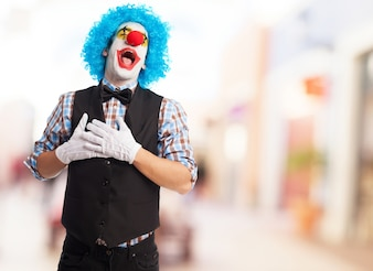 Clown with mouth open and hands on chest