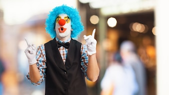 Clown with u-shaped mouth and raised fingers