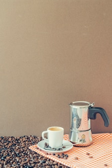 Coffee composition with cup and moka pot on cloth