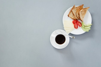 Coffee cup and toasts