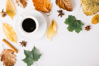 Coffee cup in arrangement with foliage
