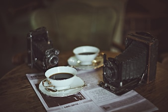 Coffee cups and an old camera