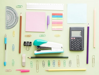 Collection of school supplies, isolated on light green background