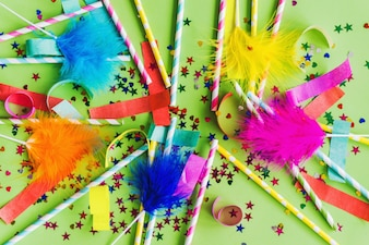 Colored sticks with feathers above