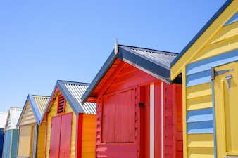 Colorful bunk houses against blue sky background.
